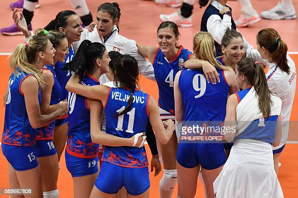 Serbia's players celebrate after winning the women's qualifying volleyball match between China and Serbia at Maracanazinho Stadium in Rio de Janeiro...