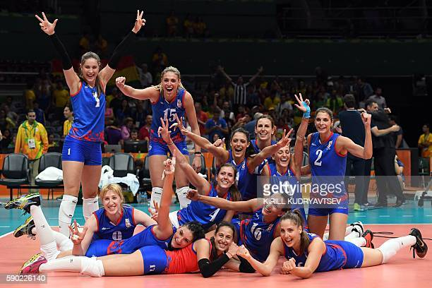 Serbia's players celebrate after winning the women's quarterfinal volleyball match between Russia and Serbia at the Maracanazinho stadium in Rio de...