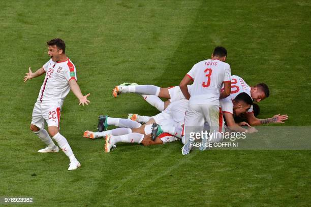 TOPSHOT Serbia's players celebrate their opening goal during the Russia 2018 World Cup Group E football match between Costa Rica and Serbia at the...