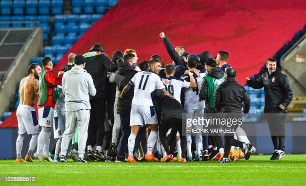 Serbia's players celebrate their team's win after the Euro 2020 play-off semi-final football match between Norway and Serbia at the Ullevaal Stadion...