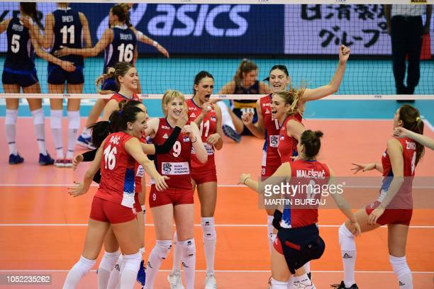 Serbia's players celebrate their victory in the 2018 FIVB World Championship volleyball women's pool G match between Italy and Serbia in Nagoya on...
