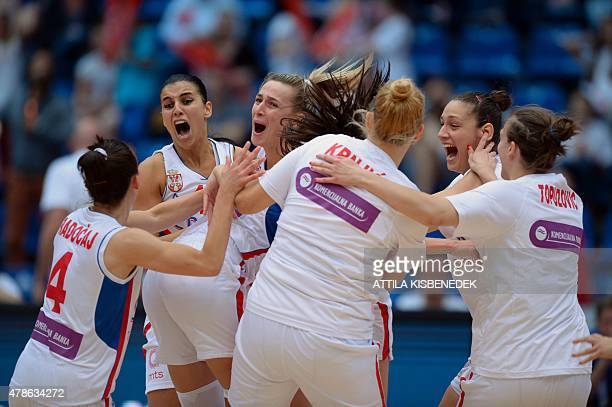 Serbia's players celebrate their victory over Belarus after a semi final basketball match between Serbia and Belarus of the EuroBasket Women 2015...