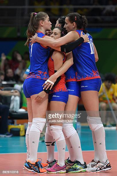 Serbia's players huddle on the court during the women's Gold Medal volleyball match between China and Serbia at Maracanazinho Stadium in Rio de...