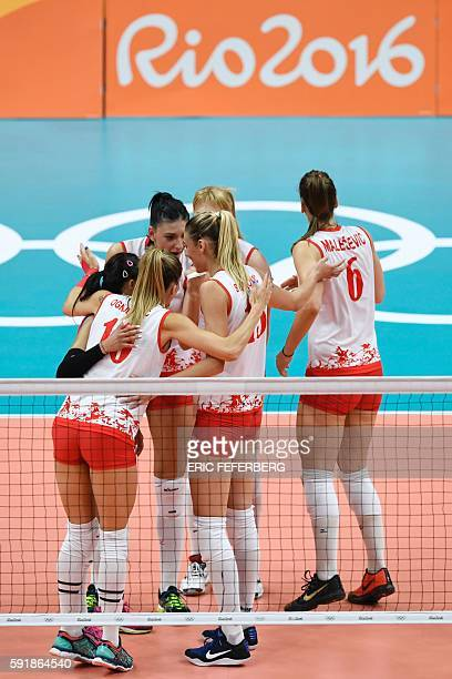 Serbia's players huddle on the court during the women's semifinal volleyball match between Serbia and USA at the Maracanazinho stadium in Rio de...