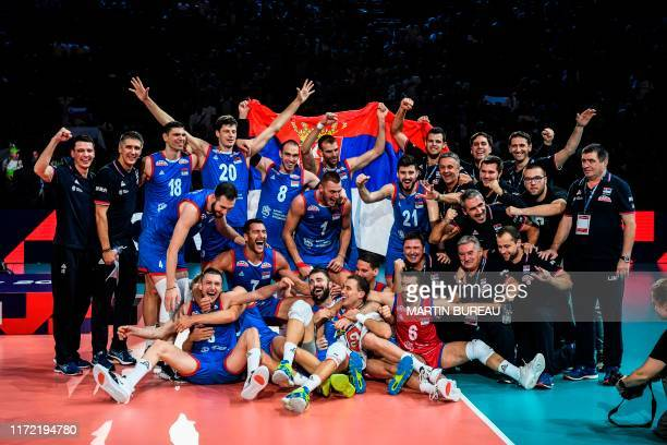 Serbia's players pose as they celebrate their victory after the Men's 2019 CEV Volleyball European Championship final match between Serbia and...