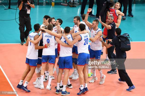 Serbia's players react after defeating France during the semi final match of the Men's 2019 CEV Volleyball European Championship between France and...