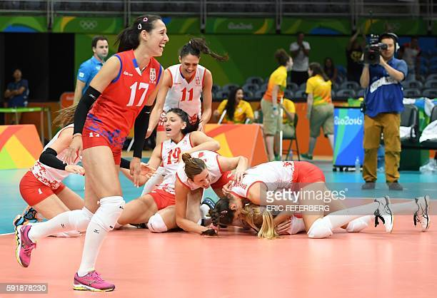 Serbia's players react after winning the women's semifinal volleyball match against USA at the Maracanazinho stadium in Rio de Janeiro on August 18...