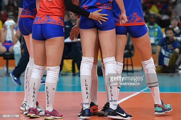Serbia's players wear socks reading 'play' and 'win' during the women's Gold Medal volleyball match between China and Serbia at Maracanazinho Stadium...