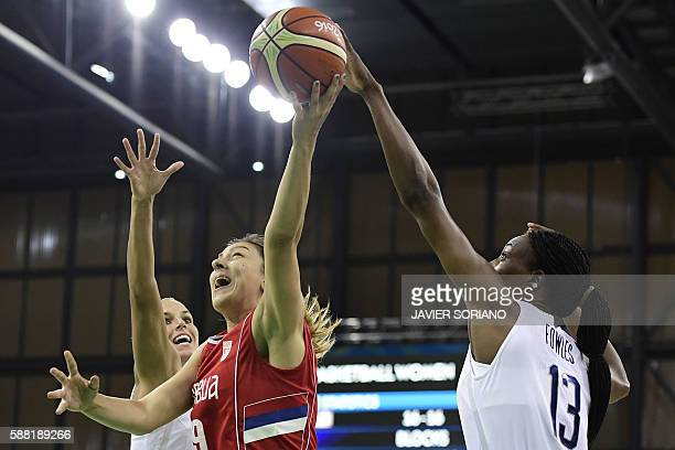Serbia's power forward Jelena Milovanovic jumps for a basket by USA's centre Sylvia Fowles during a Women's round Group B basketball match between...