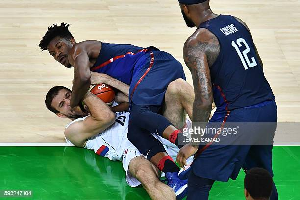 Serbia's power forward Stefan Bircevic and USA's forward Jimmy Butler tussle for the ball during a Men's Gold medal basketball match between Serbia...