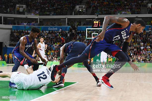 Serbia's power forward Stefan Bircevic grabs the ball with USA's forward Jimmy Butler during a Men's Gold medal basketball match between Serbia and...