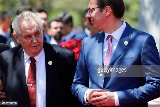 Serbia's Prime Minister Aleksandar Vucic and Czech President Milos Zeman arrive for a family photo with other delegation heads as they attend the...