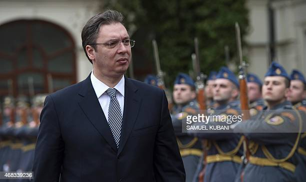 Serbia's Prime Minister Aleksandar Vucic inspects a military honor guard in Bratislava Slovakia on April 2 during a meeting with the Slovakian Prime...