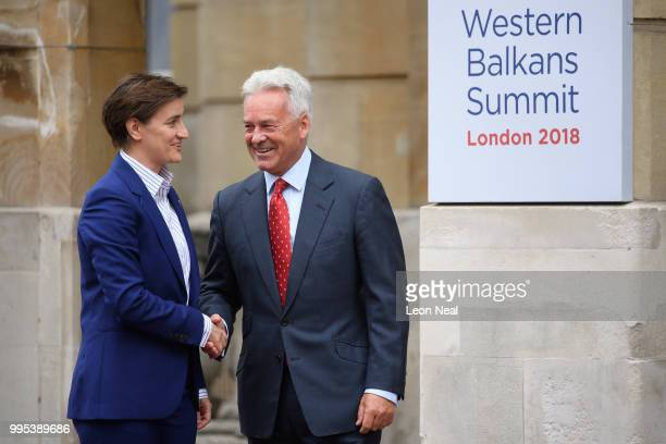 Serbia's Prime Minister Ana Brnabic is greeted by Britain's Minister of State for Europe and the Americas Alan Duncan ahead of the Western Balkans...