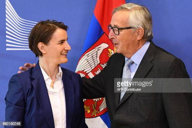 Serbia's Prime Minister Ana Brnabic is welcomed by European Commission President JeanClaude Juncker at the European Commission in Brussels on October...