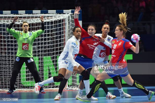Serbia's right back Marina Dmitrovic passes the ball during the Women Euro 2018 handball Championships Group 1 main round match between Serbia and...