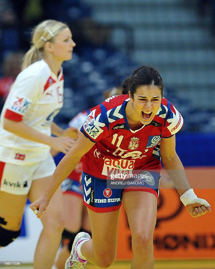 Serbia's Sanja Damjanovic (R) reacts after scoring a goal against Denmark during their Women's EHF Euro 2012 Handball Championship match Serbia vs Denmark on December 11, 2012, at the Belgrade Arena.