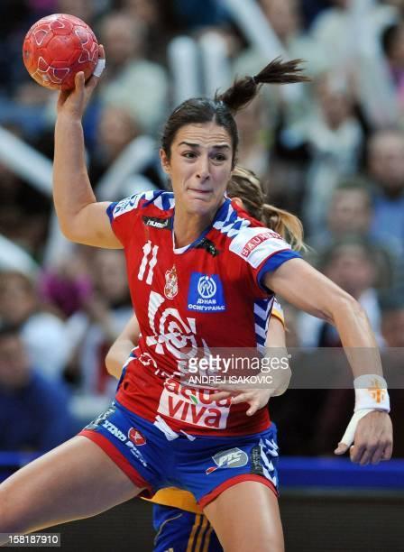 Serbia's Sanja Damjanovic vies with Sweden's Emma Hawia Svensson during their Women's EHF Euro 2012 Handball Championship match Serbia vs Sweden on...