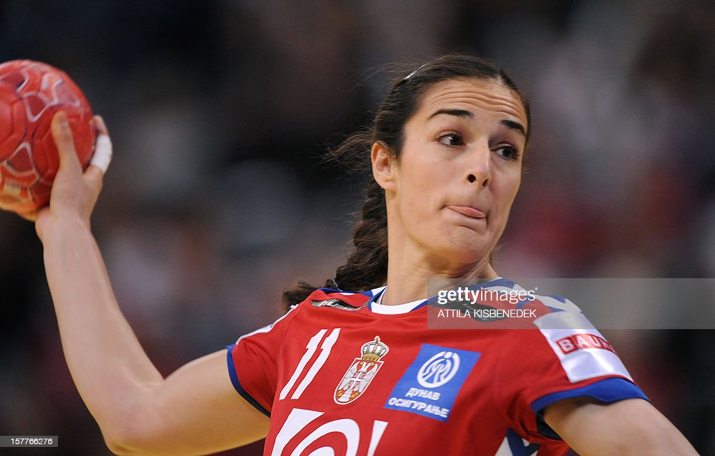 Serbia's Sanja Damnjanovic scores a goal against Ukraine during the 2012 EHF European Women's Handball Championship match on December 6, 2012, at the Kombank Arena of Belgrade. The Serbian capital Belgrade hosts the preliminary round Group A matches including Czech Republic, Norway, Serbia and Ukraine.
