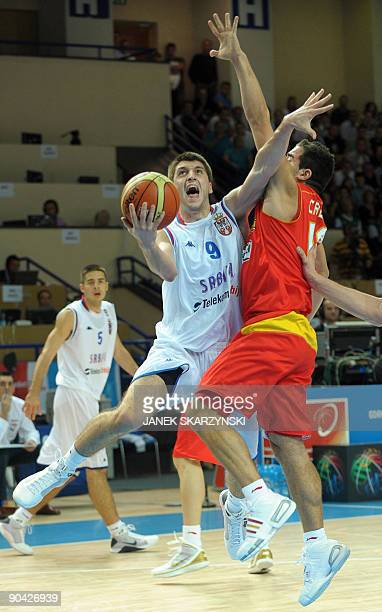 Serbia's Sefan Markovic fights for the ball with Carlos Cabezas of Spain during their 2009 European championship preliminary round group C basketball...