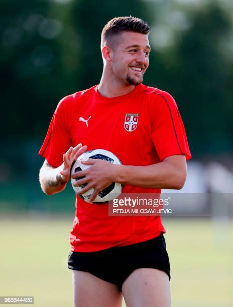 Serbia's Sergej Milinkovic Savic holds the ball during a training session on May 28 in Stara Pazova ahead of the FIFA World Cup 2018 in Russia