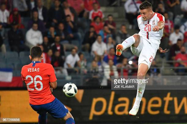 Serbia's Sergej Milinkovic Savic kicks the ball past Chile's Sebastian Vegas during the international friendly football match Serbia v Chile at the...