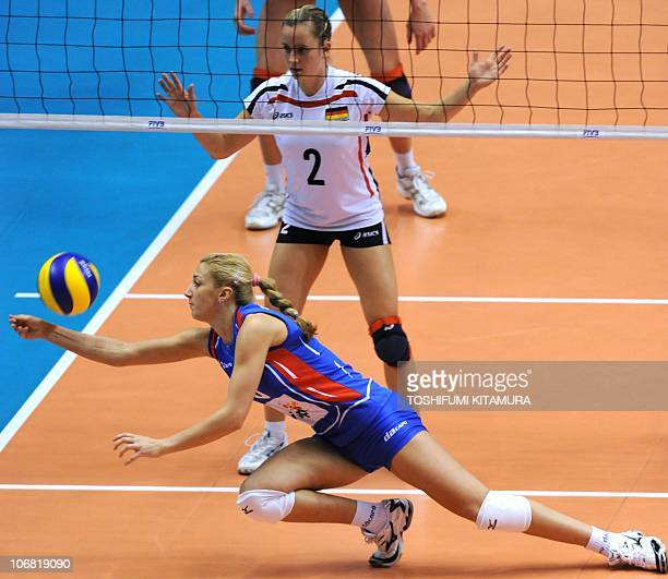 Serbia's setter Ana Antonijevic receives the ball in front of German setter Kathleen Weiss during their final round match for sixth and seventh place...