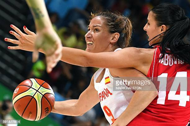 Serbia's shooting guard Ana Dabovic holds off Spain's point guard Laia Palau during a Women's semifinal basketball match between Spain and Serbia at...
