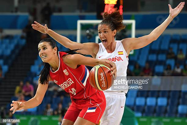 Serbia's shooting guard Ana Dabovic works around Spain's point guard Laia Palau during a Women's semifinal basketball match between Spain and Serbia...
