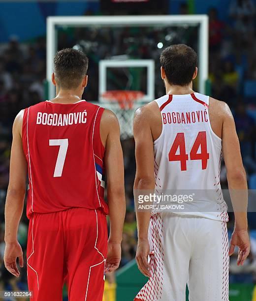 Serbia's shooting guard Bogdan Bogdanovic and Croatia's shooting guard Bojan Bogdanovic walk during a Men's quarter final basketball match between...