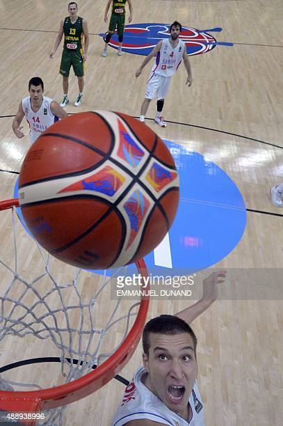 Serbia's shooting guard Bogdan Bogdanovic eyes the ball during the semifinal basketball match between Serbia and Lithuania at the EuroBasket 2015 in...