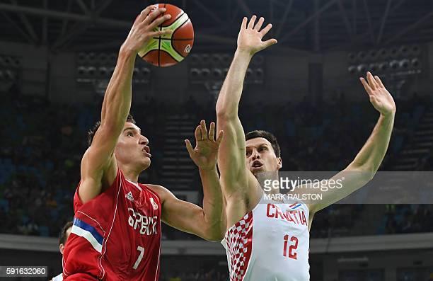Serbia's shooting guard Bogdan Bogdanovic jumps for the basket by Croatia's centre Darko Planinic during a Men's quarter final basketball match...