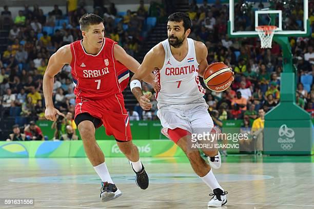 Serbia's shooting guard Bogdan Bogdanovic runs by Croatia's shooting guard Krunoslav Simon during a Men's quarter final basketball match between...