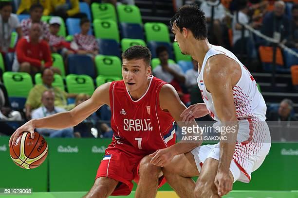 Serbia's shooting guard Bogdan Bogdanovic vies with Croatia's shooting guard Mario Hezonja during a Men's quarter final basketball match between...