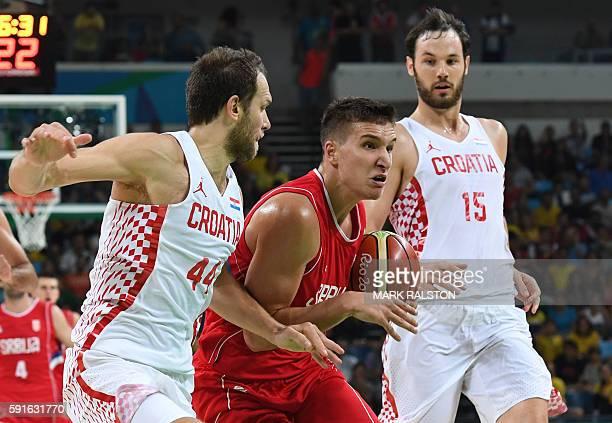 Serbia's shooting guard Bogdan Bogdanovic vies with Croatia's shooting guard Bojan Bogdanovic during a Men's quarter final basketball match between...