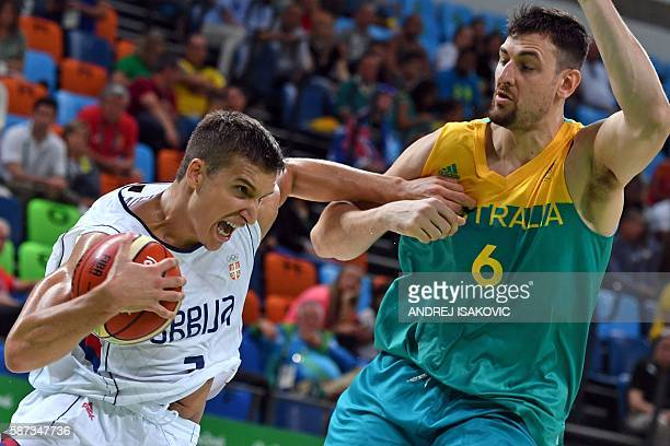 TOPSHOT Serbia's shooting guard Bogdan Bogdanovic works around Australia's centre Andrew Bogut during a Men's round Group A basketball match between...