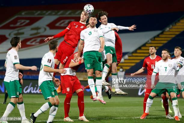 Serbia's Strahinja Pavlovic fights for the ball with Ireland's Enda Stevens and Alan Browne during the FIFA World Cup Qatar 2022 qualification...