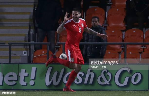 Serbia's striker Aleksandar Mitrovic celebrates scoring the opening goal during the International friendly football match between Nigeria and Serbia...