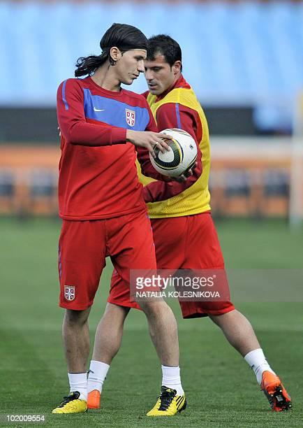 Serbia's striker Marko Pantelic trains with midfielder Dejan Stankovic during a team official training session at the Loftus Versfeld Stadium in...