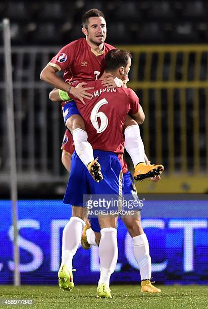 Serbia's striker Zoran Tosic celebrates with teammate defender Branislav Ivanovic after scoring a goal during the EURO 2016 group I football match...