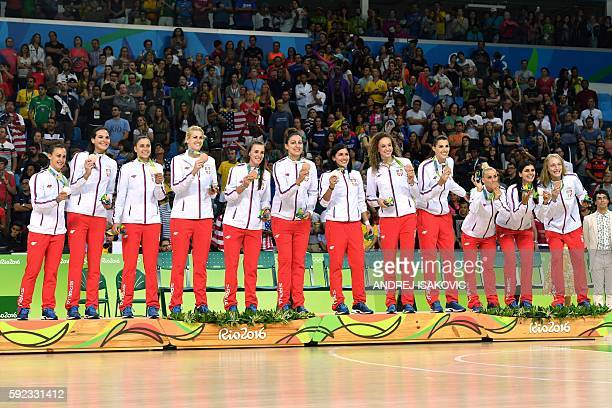 Serbia's team pose with their bronze medals on the podium after the final of the Women's basketball competition at the Carioca Arena 1 in Rio de...