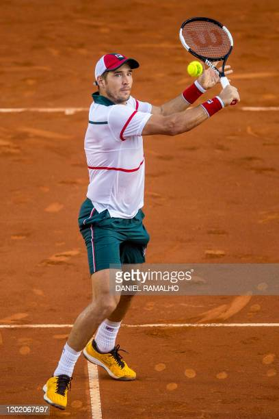 Serbia's tennis player Dusan Lajovic returns a backhand during his ATP World Tour Rio Open 2020 tournament match against Italy's Lorenzo Sonego at...