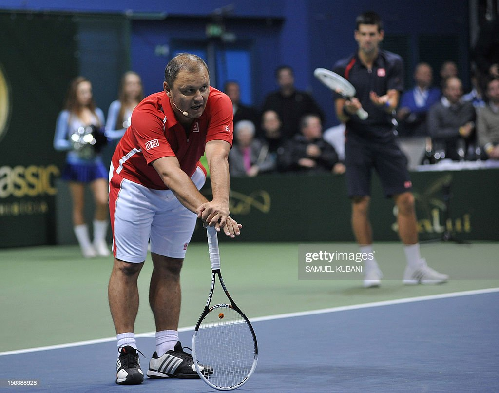 Serbia's tennis player Novak Djokovic (R) and his coach Marian Vajda react during a Tennis Classic exhibition match against Slovakian Dominik Hrbaty and Martin Klizan on November 14, 2012 in Bratislava.