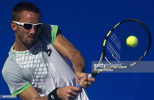 Serbia's tennis player Viktor Troicki returns the ball to South Africa's tennis player Kevin Anderson during the Mexico ATP tournament in Acapulco,...