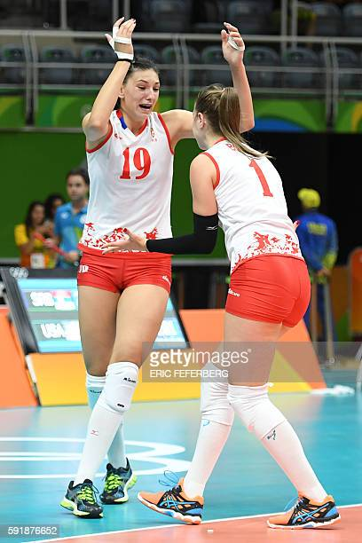 Serbia's Tijana Boskovic and Serbia's Bianka Busa celebrate after winning the women's semifinal volleyball match against USA at the Maracanazinho...