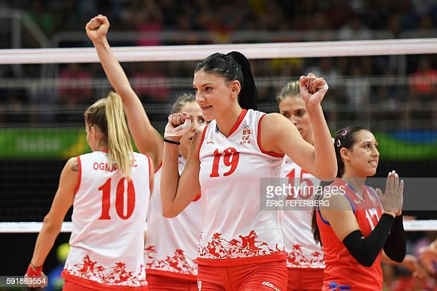 Serbia's Tijana Boskovic and teammates celebrate after scoring during the women's semifinal volleyball match between Serbia and USA at the...