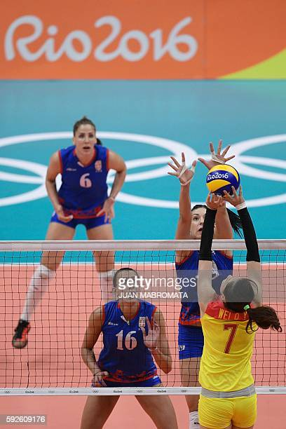 Serbia's Tijana Boskovic jumps up to block the ball during the women's Gold Medal volleyball match between China and Serbia at Maracanazinho Stadium...