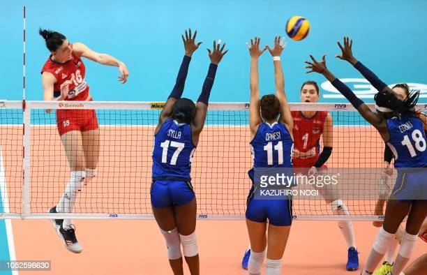 Serbia's Tijana Boskovic spikes the ball against Italy's Paola Ogechi Egonu Anna Danesi Miriam Fatime Sylla during the 2018 FIVB World Championship...