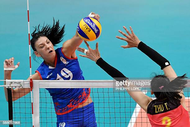Serbia's Tijana Boskovic spikes the ball during the women's qualifying volleyball match between China and Serbia at Maracanazinho Stadium in Rio de...