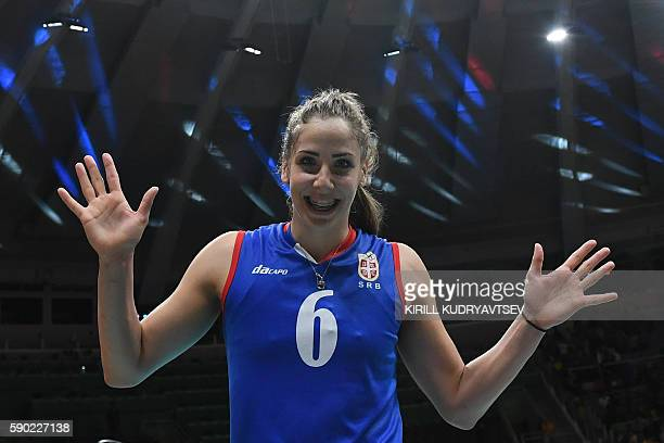 Serbia's Tijana Malesevic celebrates after winning the women's quarterfinal volleyball match between Russia and Serbia at the Maracanazinho stadium...